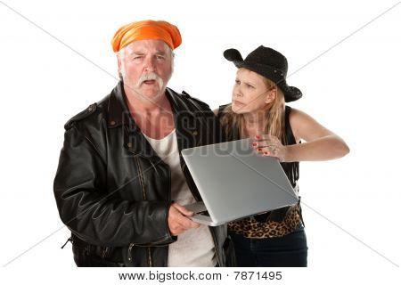 Mature Biker Couple Arguing about a Computer
