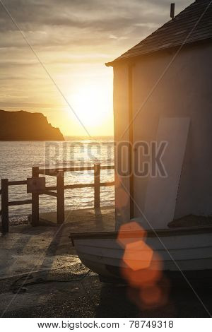 Lovely Sunrise Behind Fishing Hut In Lulworth Cove With Added Lens Flare