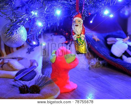 plasticine trying to eat chocolate Santa
