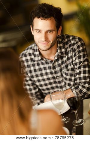 Happy Young Man In A Restaurant