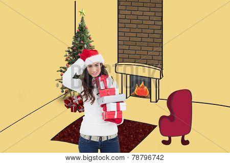 Stressed brunnette in santa hat holding gifts against yellow vignette