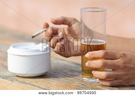 Hands Holding A Cigarette Smoking And Drinking Alcohol