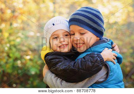 Happy embracing children