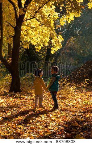 Happy children walking in the autumn park