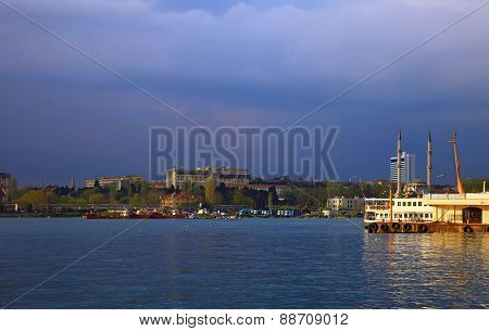 View of the Kadikoy, Istanbul. Twilight. Cloudy Sky. poster