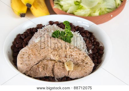 Creole Cuban Cuisine: White Rice,black Beans And Pork Steak