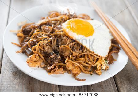 Fried Char Kuey Teow which is a popular noodle dish in Malaysia, Indonesia, Brunei and Singapore