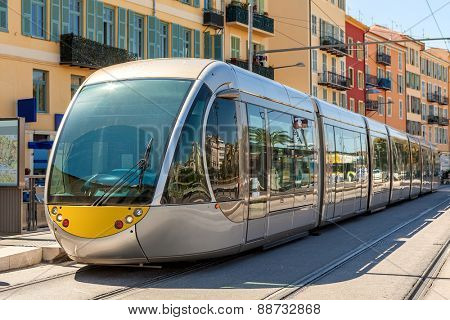 Modern tram on the stop in city of Nice, France.