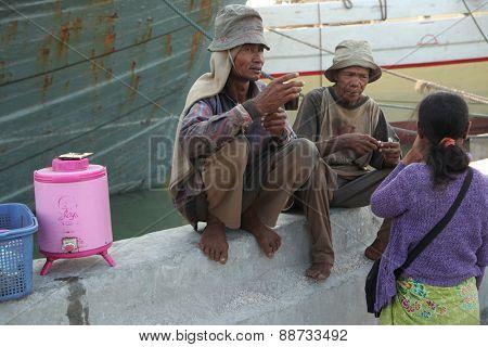 JAKARTA, INDONESIA - AUGUST 16, 2011: Stevedores dink tea in the historical port of Sunda Kelapa in Jakarta, Central Java, Indonesia.