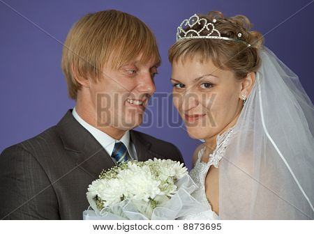 Bride And Groom On Purple Background