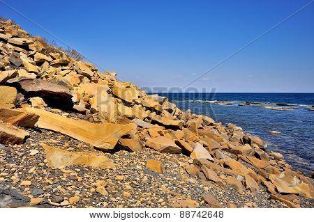Yellow Stones On The Beach