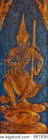 Metal Relief Picture Of Buddist Diety At Wat Kaew Korawaram Temple