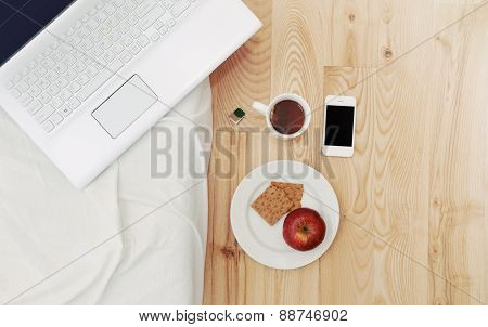 Modern Still Life Of Morning Breakfast Routine With Computer Device, Stuff And Some Snack