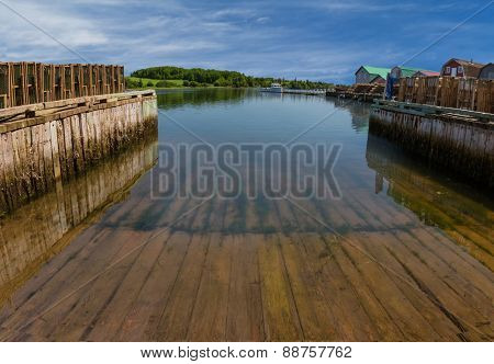 A boat slip at a commercial lobster fishing wharf in rural Prince Edward Island, Canada.