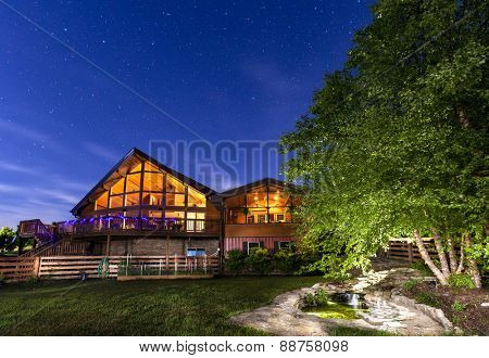 Modern house with koi pond under starry skies