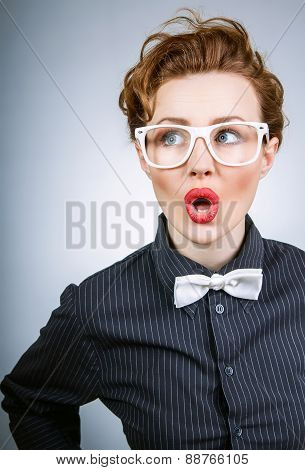 Portrait Of A Surprised Stylish Woman Thinking, Close Up