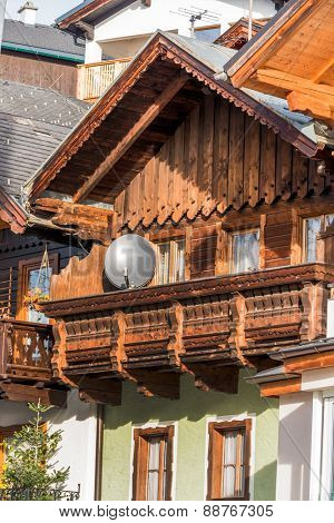 traditional house with satellite dish, symbol of communication, radio, television, internet