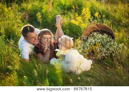Happy Family Having Fun Outdoors In Summer Meadow