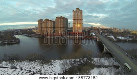 MOSCOW, RUSSIA - APR 02, 2014: Residential complex Scarlet Sails on river shore at evening, aerial view. Tallest building of complex is 179 meters high