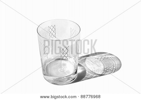 Decorated clear glass with some water isolated