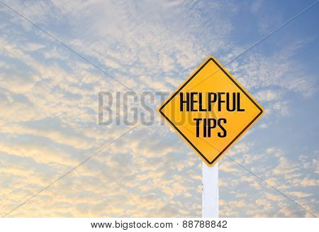 Road Sign Indicating Helpful Tips On Blurred Sky Background