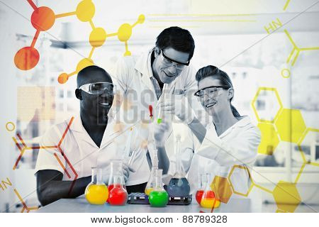 Science and medical graphic against group of smiling scientists examining testtubes