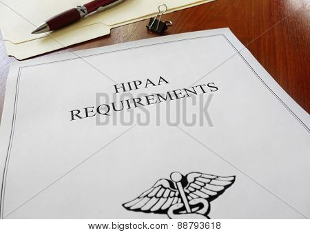 HIPAA healthcare requirements document with folder and pen poster