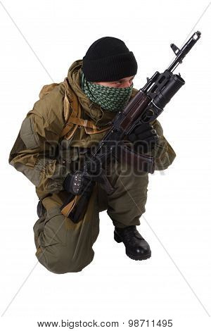 terrorist with kalashnikov rifle with under-barrel grenade launcher isolated on white background poster