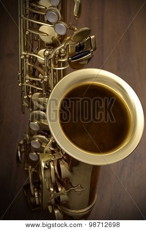 saxophone in wood background
