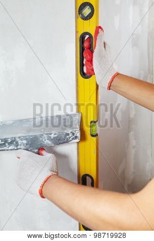 Contractor working with metre measure ruler. The builder poster