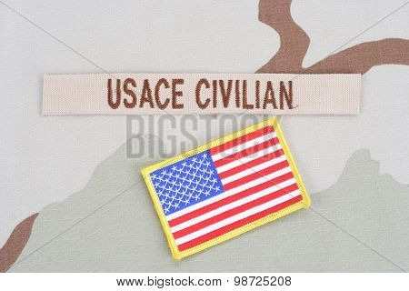 Kiev, Ukraine - June 14, 2015. Usace Civilan Branch Tape With Flag Patch On Desert Camouflage Unifor