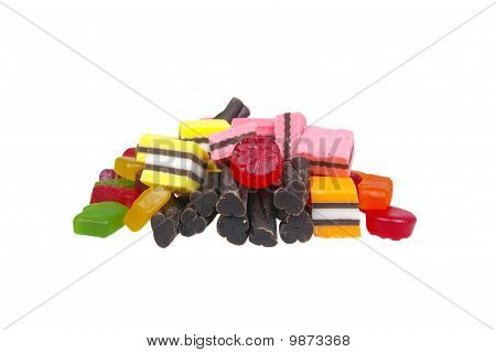 soft colored jelly lollies and licorice isolated over white poster