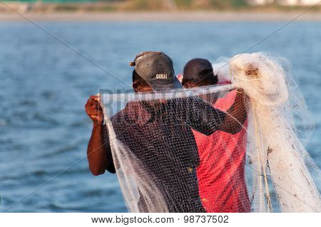 Fisherman  With Net  On The Beach