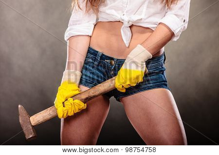 Closeup Of Sexy Woman Holding Hammer. Feminism.