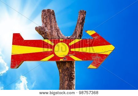 Macedonia Flag wooden sign with sky background poster