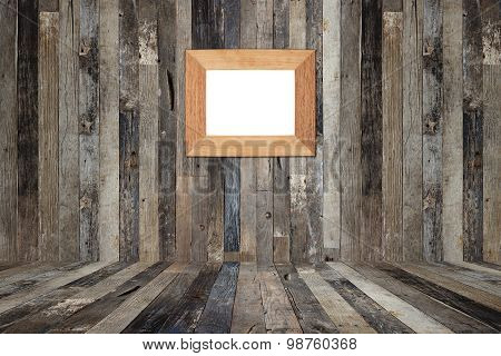 Wooden Picture Frame On The Old Wooden Wall