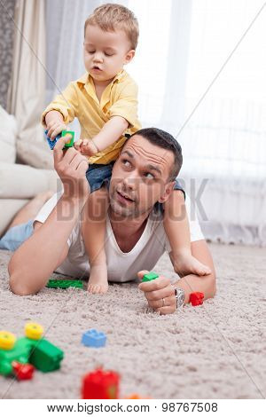 Cheerful man and his child are spending time together