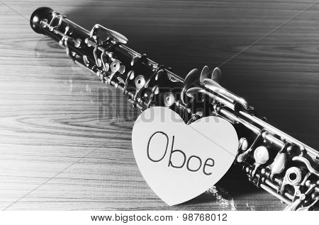 oboe with heart on wood background black and white color tone style