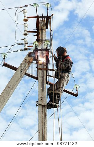 Electrician Connects Metal Parts Ground Loop On A Pole Transmission Line