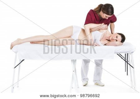 physiotherapist gets mobilisation of a shoulder to patient