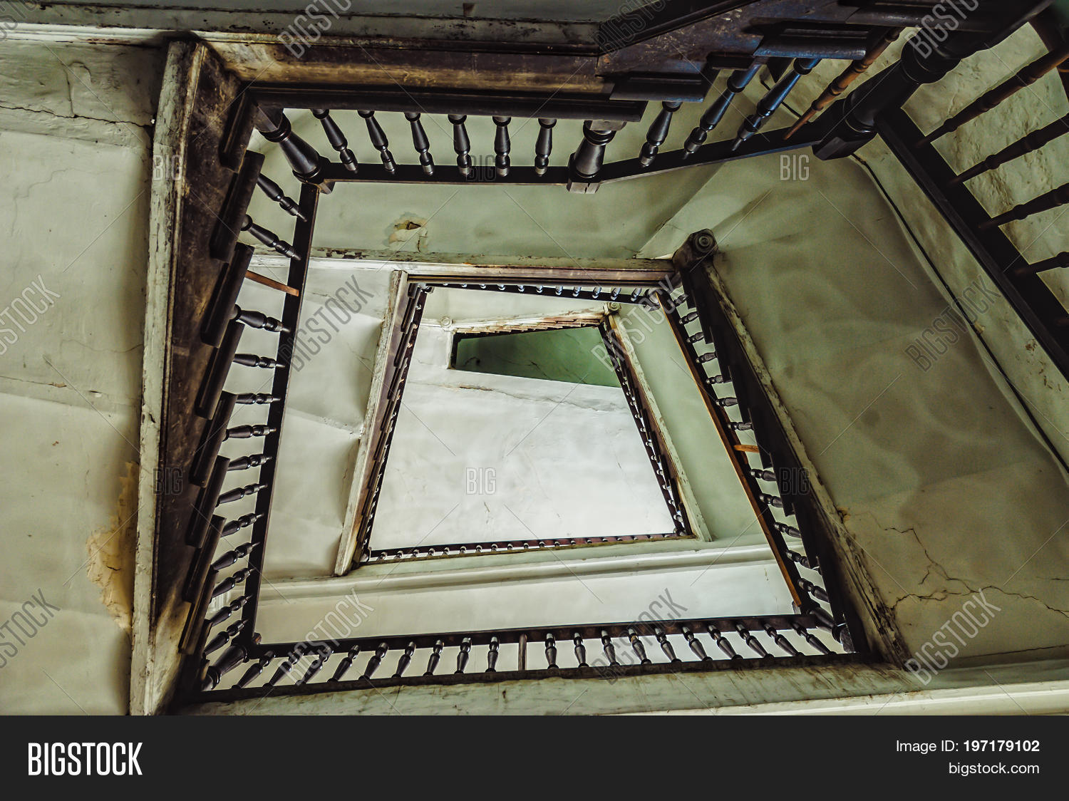 Square Spiral Staircase In Old Building. Upside View Antique Architecture  Background.