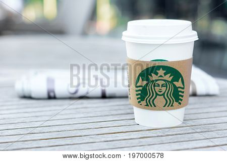 Bangkok Thailand - Feb 26 2015 : Starbucks coffee cup on the table Starbucks brand is one of the most world famous coffeehouse chains from USA.