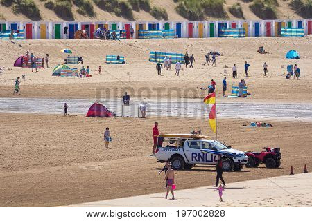 Woolacombe Devon England 14 July 2016: Beach Woolacombe with vacationers. Coast Guard Vehicle