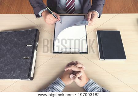 Job interview Young attractive executives man reading his resume work history of applicant in a clipboard colloquy dream Skill expertise experience and businessman listen to candidate answers.