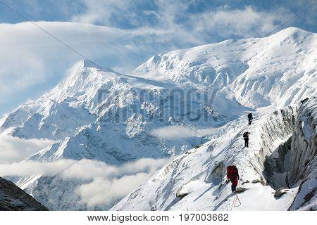 View of Annapurna 3 III and group of tourist round Annapurna circuit trekking trail Nepal