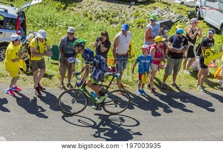 Col du Grand ColombierFrance - July 17 2016: The Spanish cyclist Ruben Plaza Molina of Orica-BikeExchange Team riding on the road to Col du Grand Colombier in Jura Mountains during the stage 15 of Tour de France 2016.