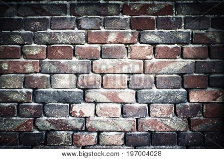 old brick wall for texture or background, vignette effect