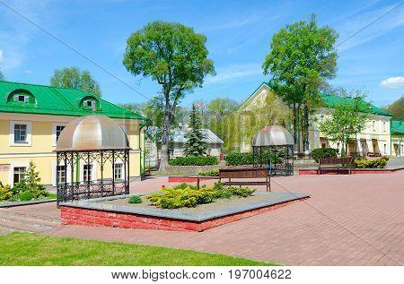 POLOTSK BELARUS - MAY 19 2017: Complex of buildings of former Jesuit collegium (now - Polotsk State University) Belarus. Unknown girl is sitting in gazebo