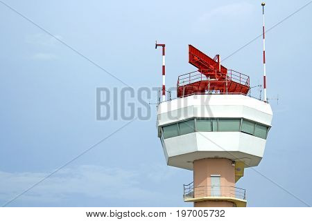 The airport control tower has a red star on top.