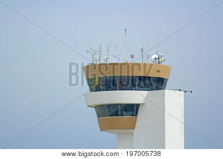 Airport control tower brown lack of white on daylight